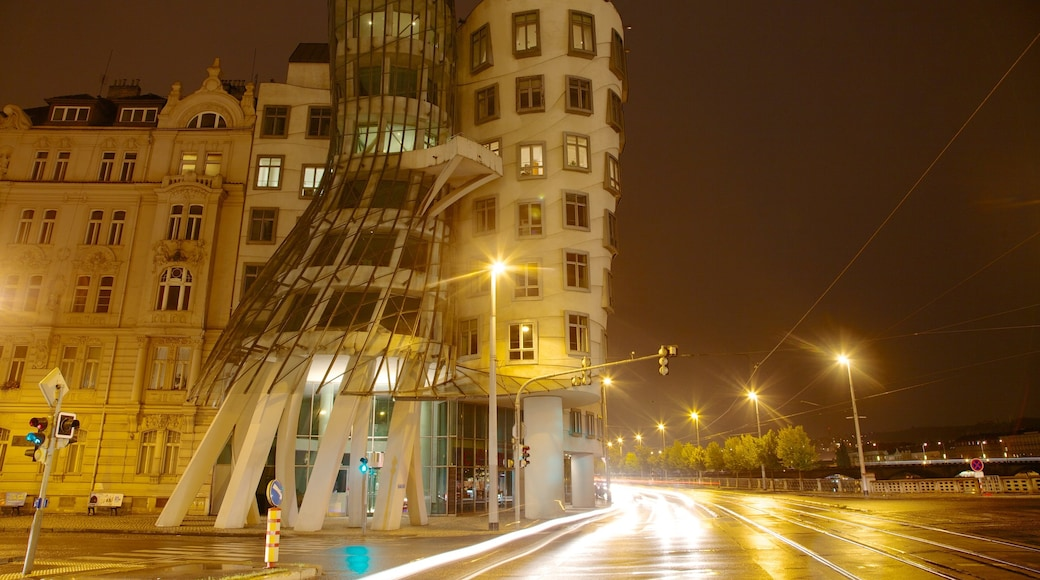 Prague Dancing House featuring night scenes, a city and street scenes