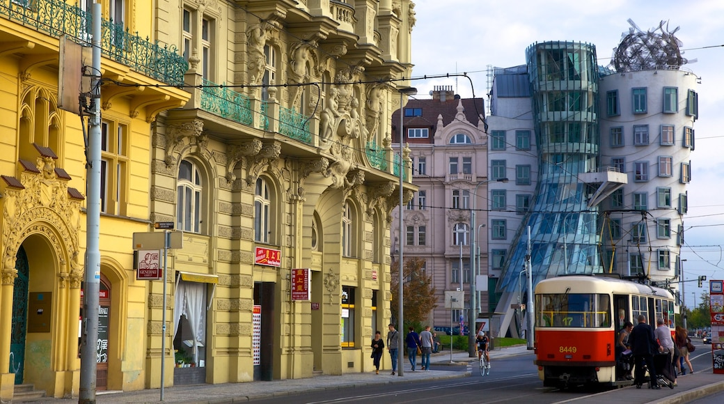 Prague Dancing House which includes modern architecture, a city and street scenes