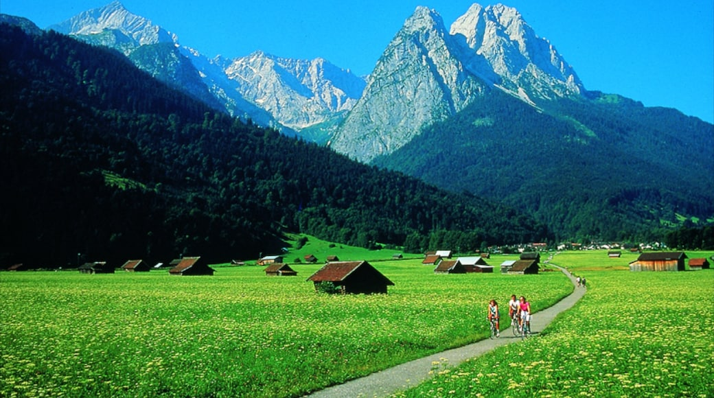 Garmisch-Partenkirchen showing mountains, a small town or village and road cycling