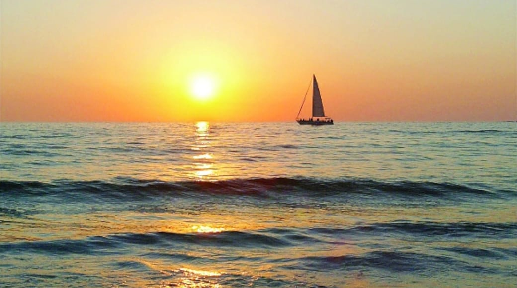 Clearwater Beach which includes general coastal views, a sunset and sailing