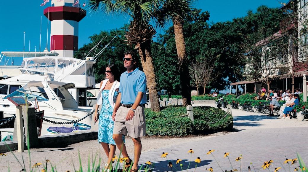 Hilton Head showing a marina and a coastal town as well as a couple