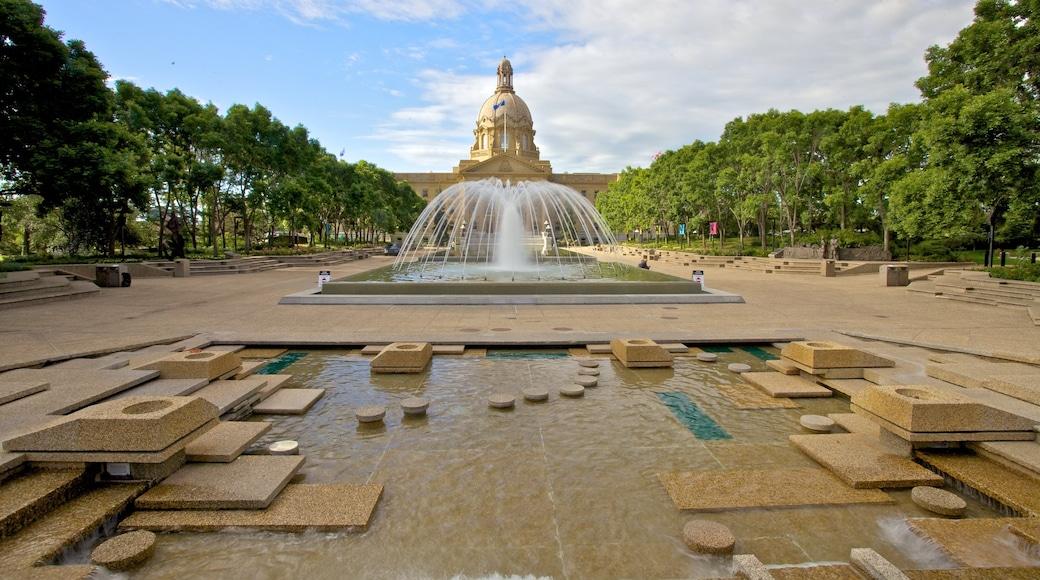 Alberta Legislature Building featuring heritage architecture, a fountain and a square or plaza