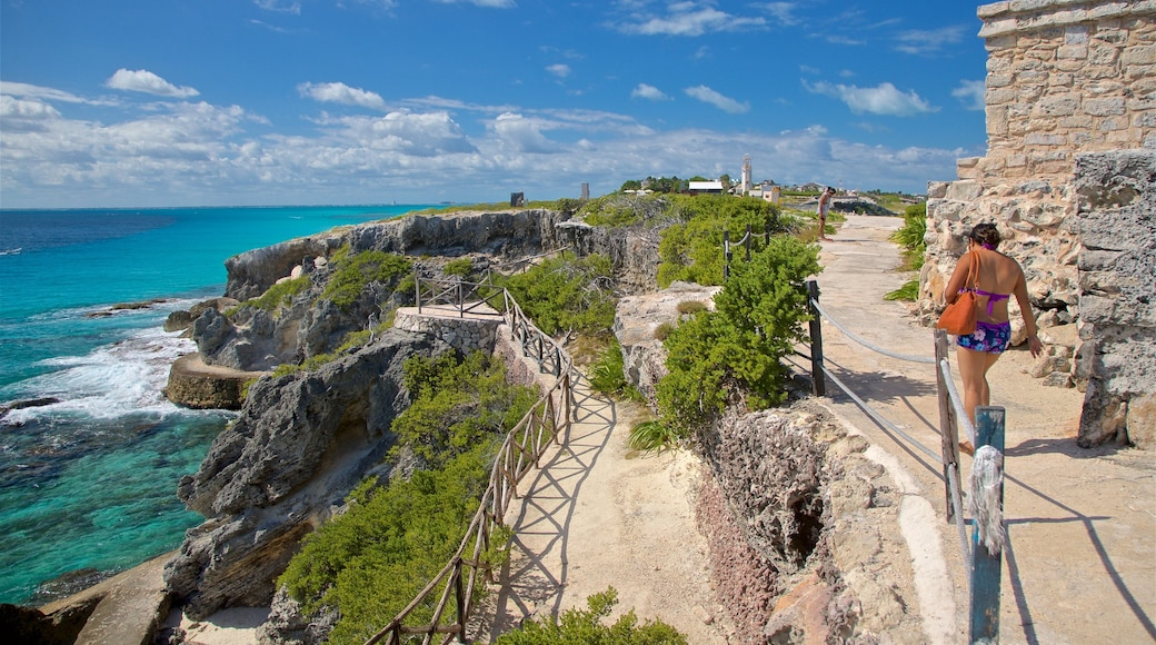 Isla Mujeres featuring general coastal views and rugged coastline as well as an individual femail