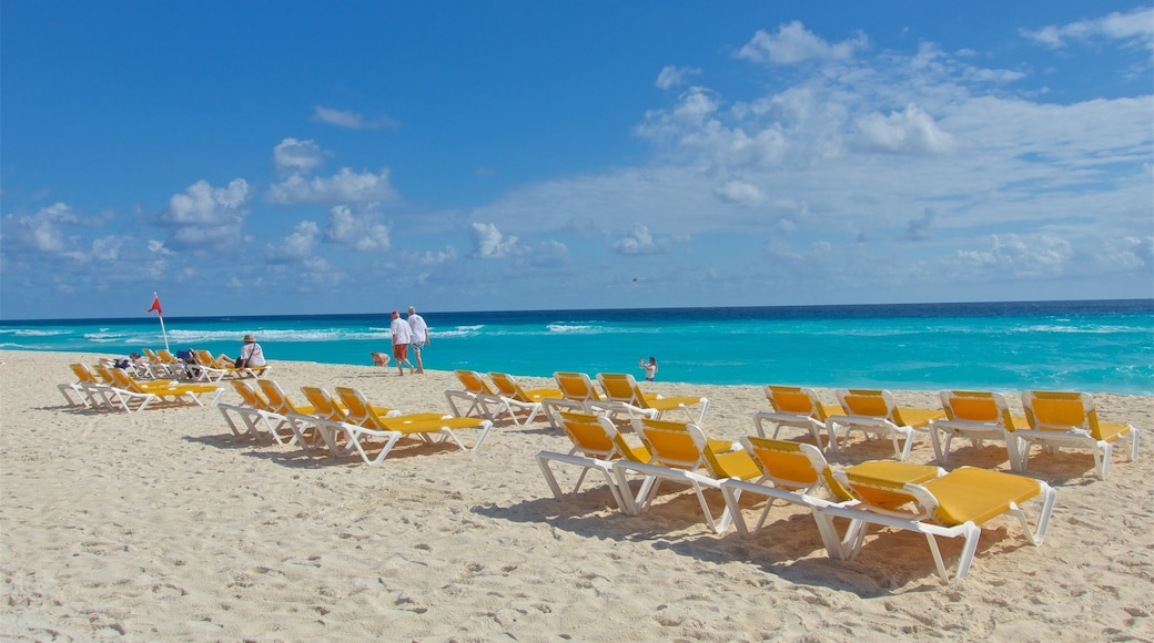 Playa Delfines which includes a sandy beach, tropical scenes and general coastal views