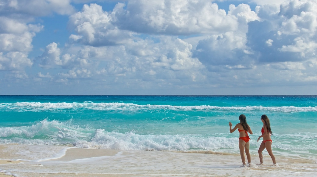 Playa Delfines which includes a beach and general coastal views as well as a couple
