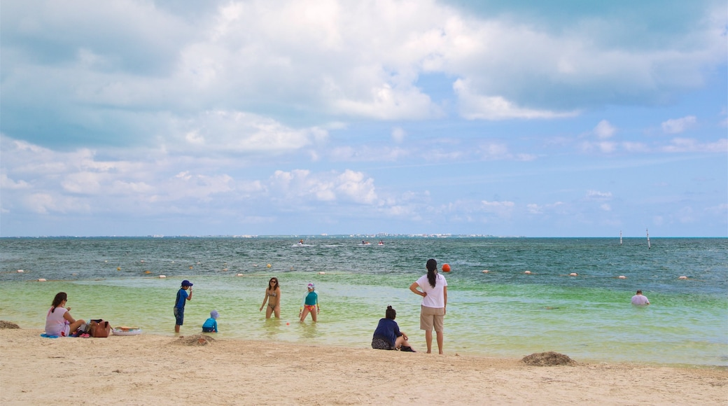 Playa Linda which includes a sandy beach, swimming and general coastal views