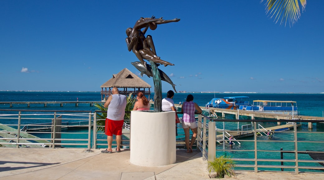Dolphin Discovery showing outdoor art and general coastal views as well as a small group of people