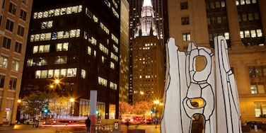 Downtown Chicago featuring night scenes, outdoor art and a city