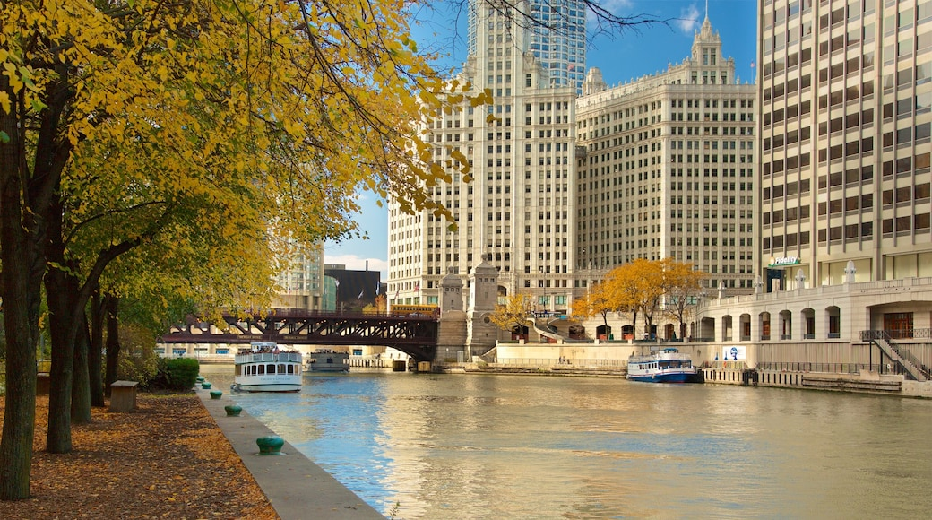 Chicago Riverwalk featuring a river or creek, a bay or harbour and a city