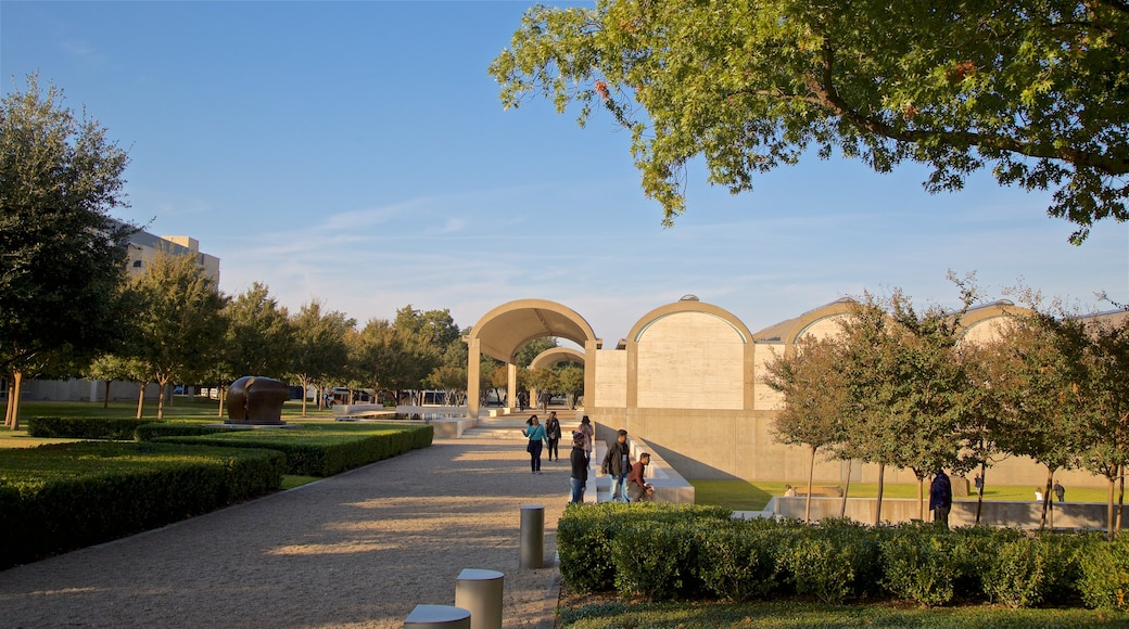 Kimbell Art Museum showing a park as well as a small group of people