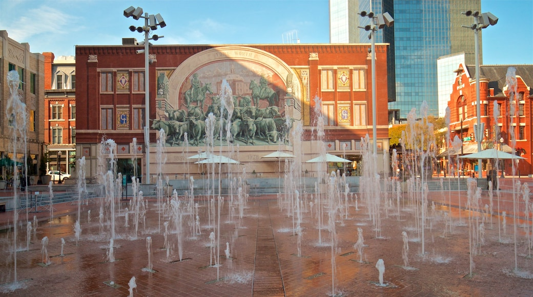 Sundance Square featuring a square or plaza and a fountain