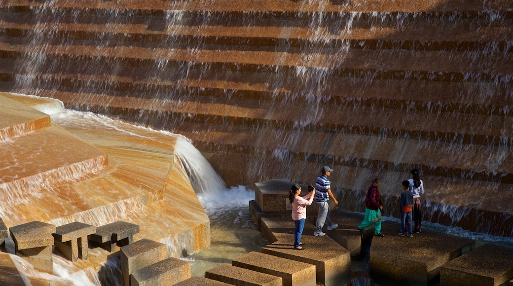 Fort Worth Water Gardens which includes a fountain as well as a small group of people