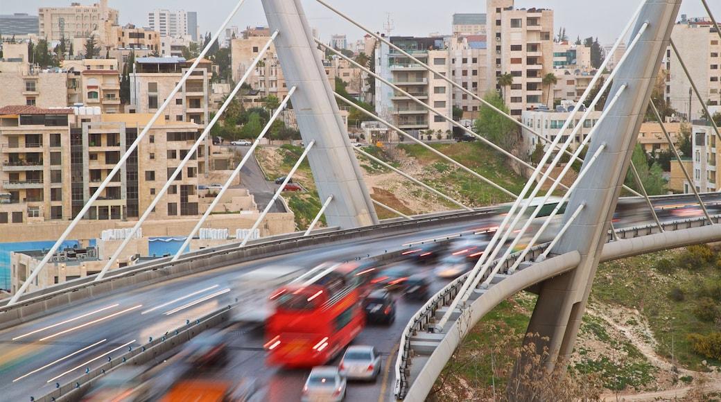 Abdoun Bridge which includes landscape views, a bridge and a city