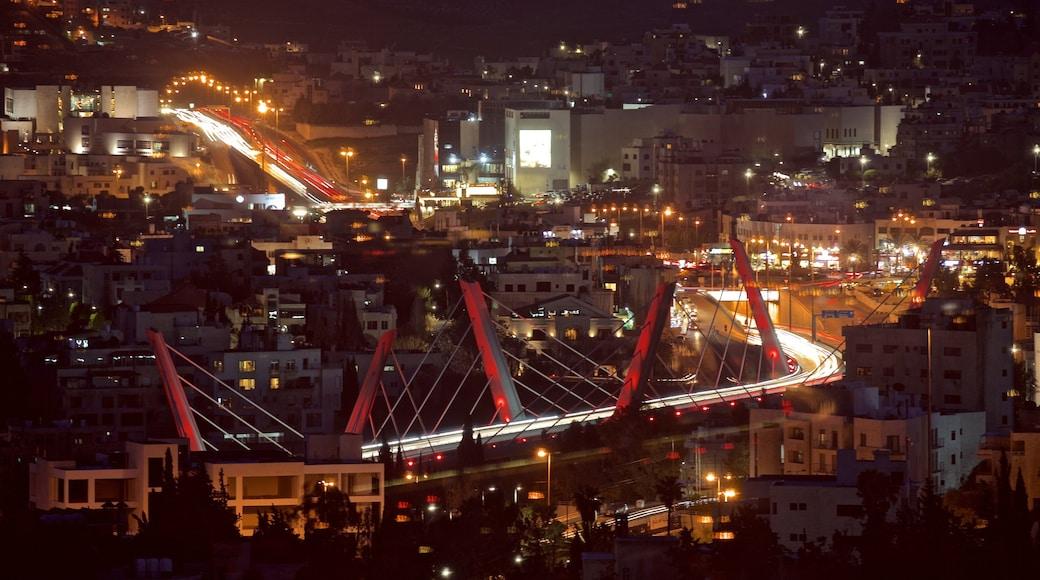 Abdoun Bridge which includes landscape views, night scenes and a bridge
