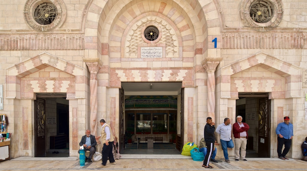 King Hussein Mosque which includes heritage elements and street scenes as well as a small group of people