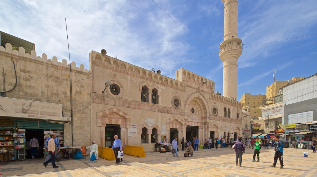 King Hussein Mosque featuring heritage elements and street scenes as well as a small group of people