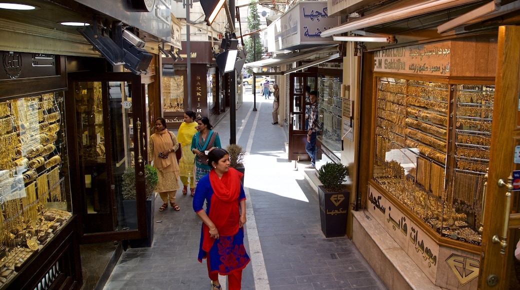 Gold Souk showing street scenes and shopping as well as an individual male