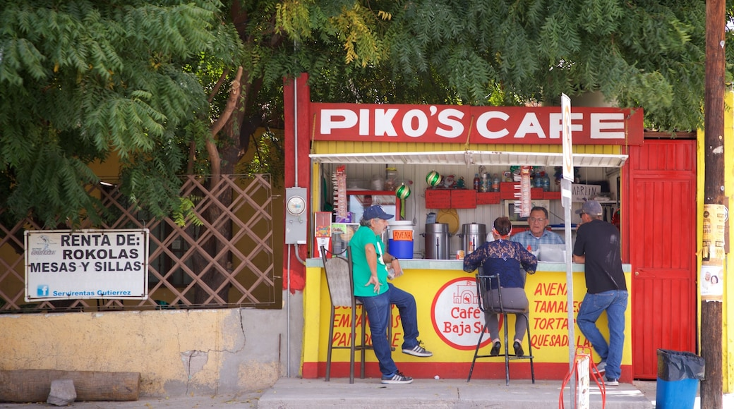 La Paz which includes signage and outdoor eating as well as a small group of people