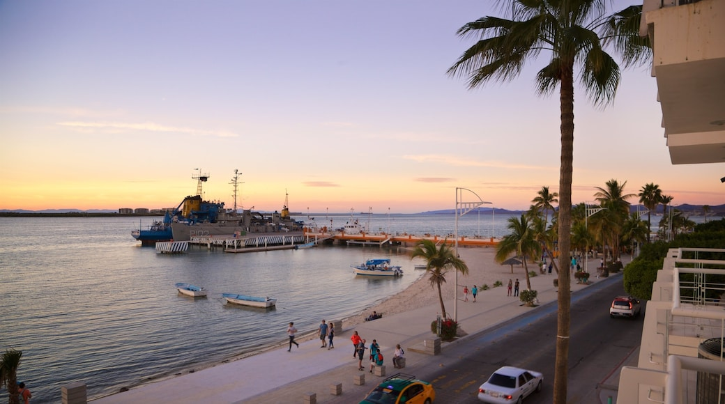 St Maarten and St Martin which includes a sunset and general coastal views