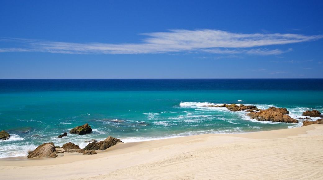 Migrino which includes a sandy beach, rocky coastline and general coastal views