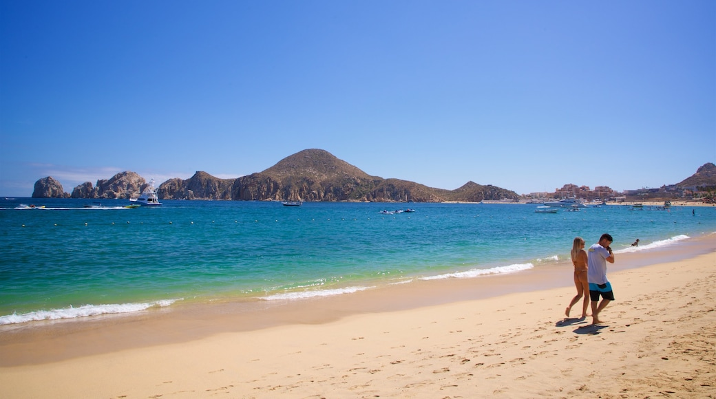 Medano Beach which includes general coastal views and a sandy beach as well as a couple