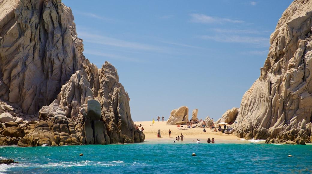 Playa del Amor showing general coastal views and rocky coastline