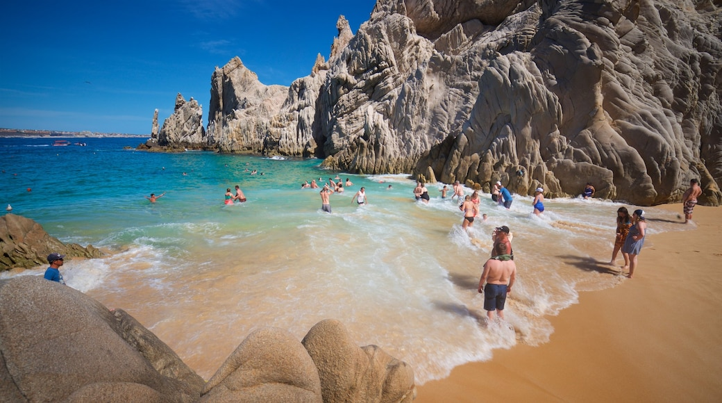 Playa del Amor which includes general coastal views, swimming and rugged coastline