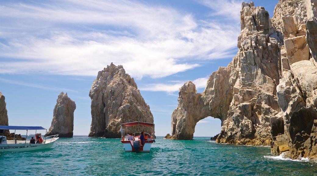 El Arco showing general coastal views, boating and rocky coastline