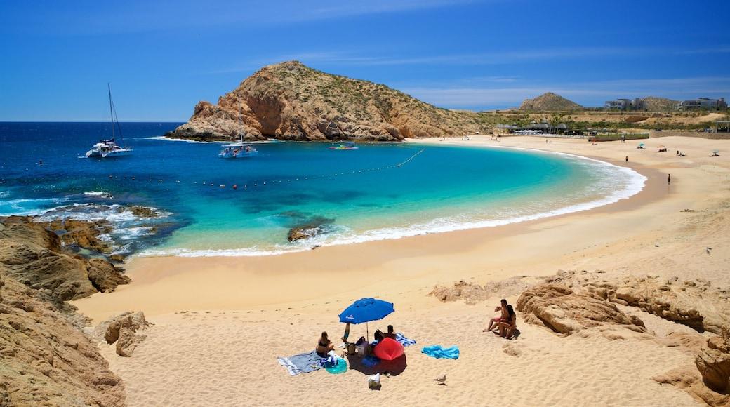 Santa Maria Beach featuring rocky coastline, a beach and general coastal views