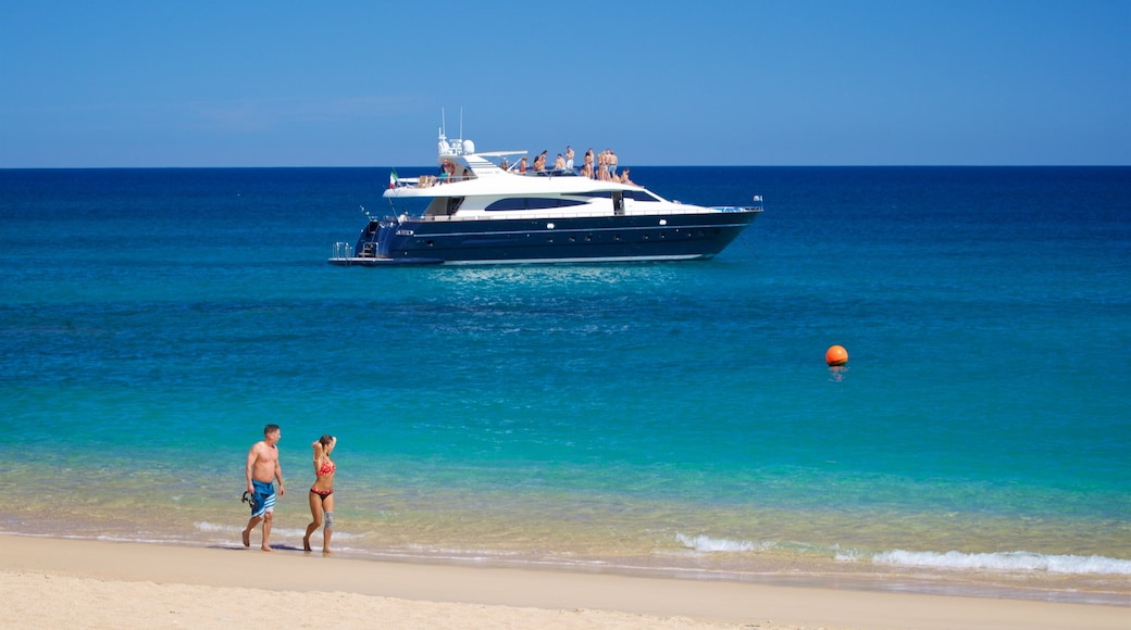 Chileno Beach which includes general coastal views, boating and a sandy beach