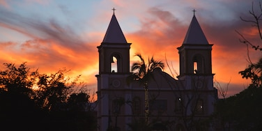 Mission of San Jose featuring a sunset and a church or cathedral
