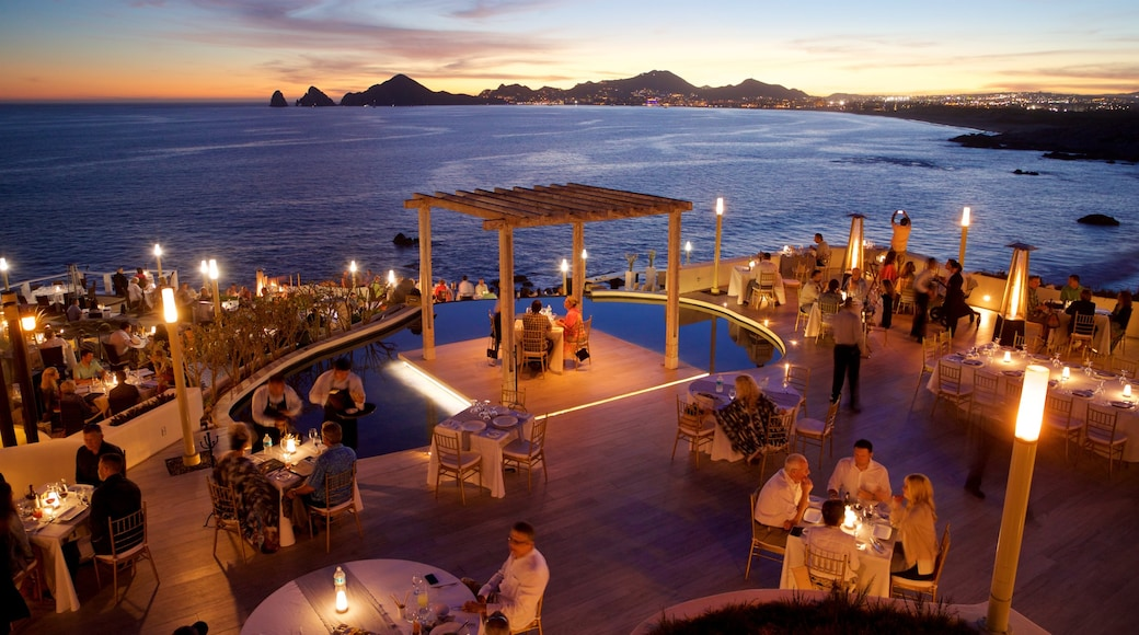 St Maarten and St Martin which includes outdoor eating, general coastal views and night scenes