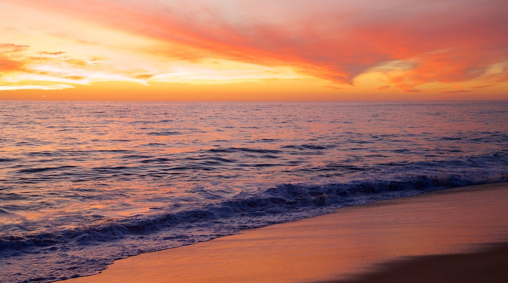 Todos Santos which includes a beach, general coastal views and a sunset