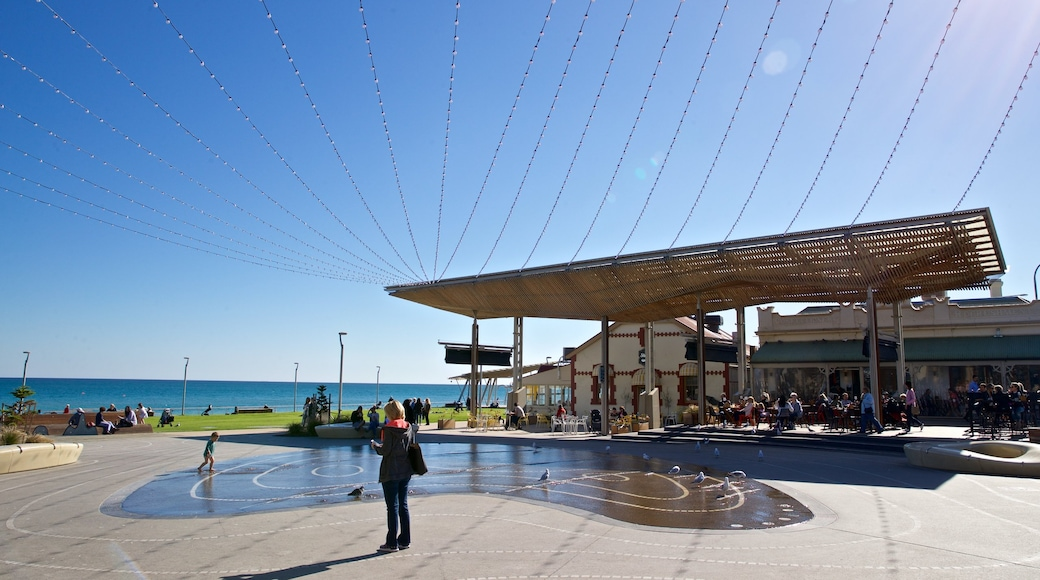 Henley Beach which includes a fountain and a square or plaza as well as a family
