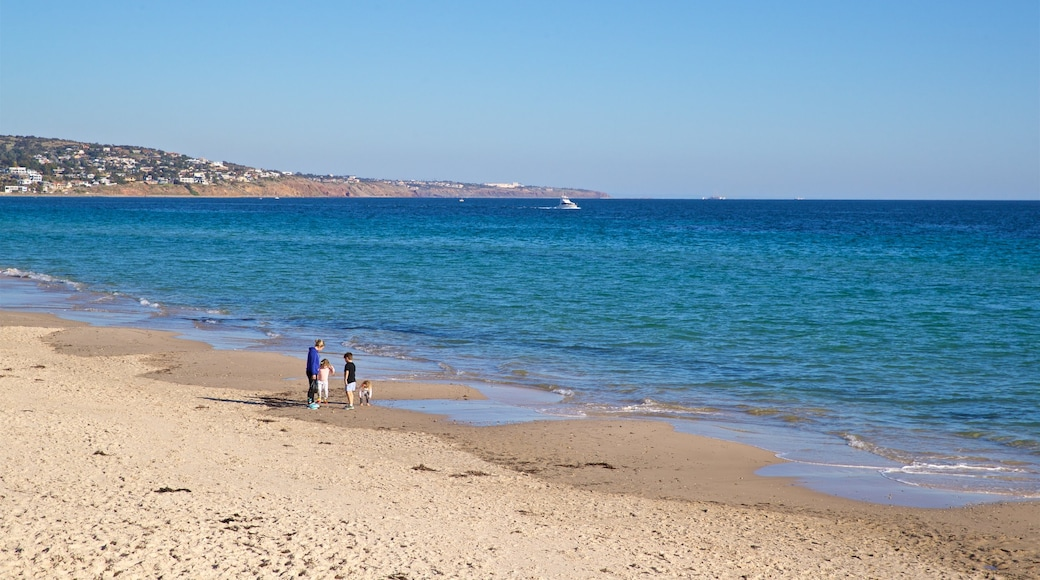 Brighton Beach which includes a beach and general coastal views as well as a family
