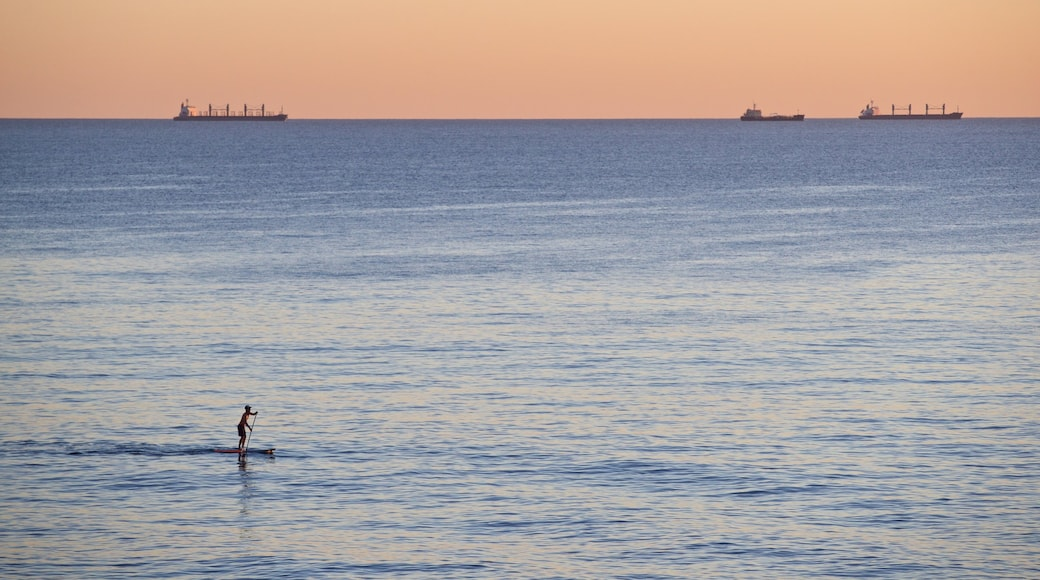 Cottesloe Beach featuring kayaking or canoeing, general coastal views and a sunset