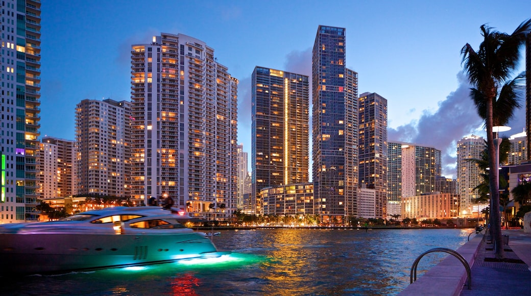 Downtown Miami which includes a river or creek, night scenes and boating