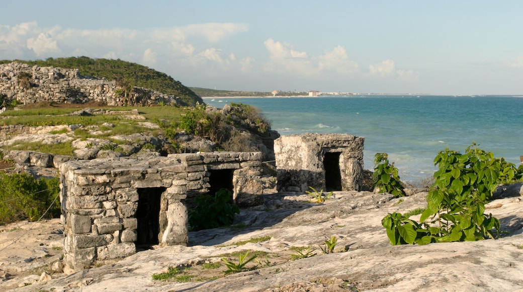 Tulum Mayan Ruins featuring building ruins and rocky coastline