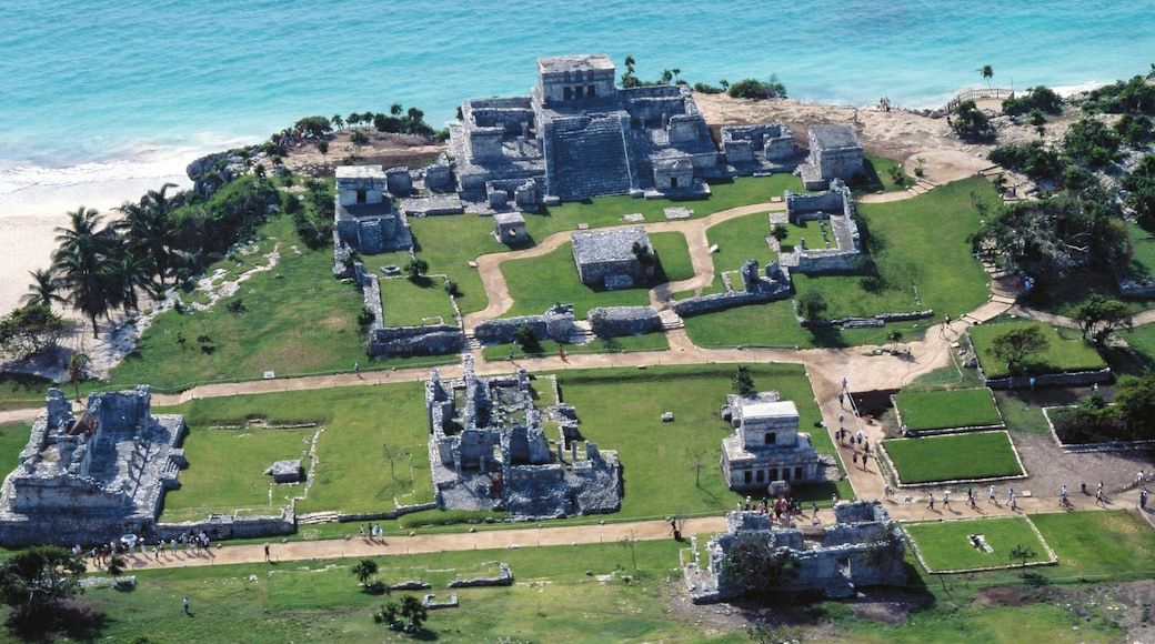 Tulum National Park which includes general coastal views, building ruins and heritage architecture