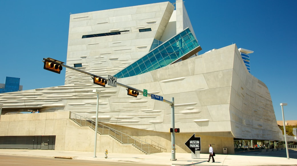 Perot Museum of Nature and Science showing signage as well as an individual male