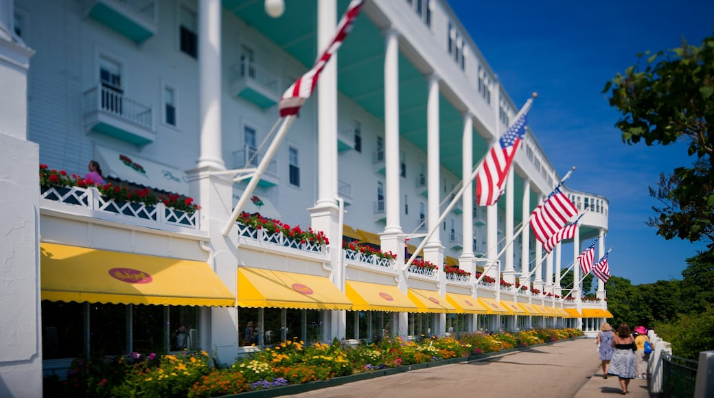 Mackinac Island which includes flowers, modern architecture and street scenes