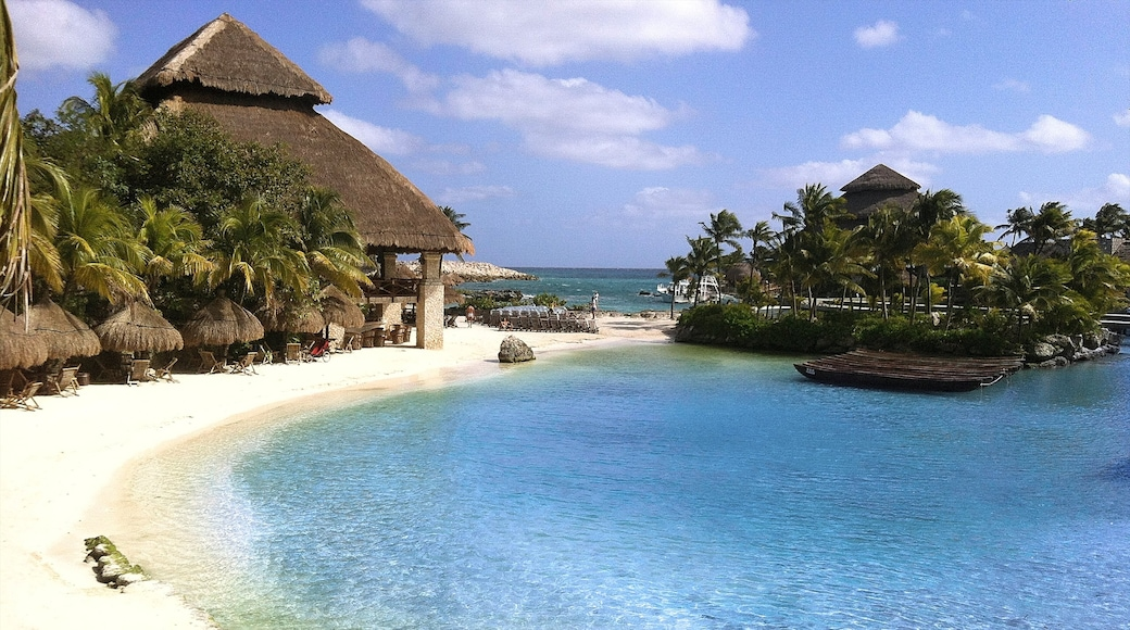 Xcaret Eco Theme Park featuring a sandy beach, skyline and tropical scenes