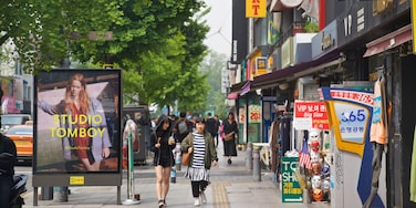 Itaewon which includes street scenes as well as a couple