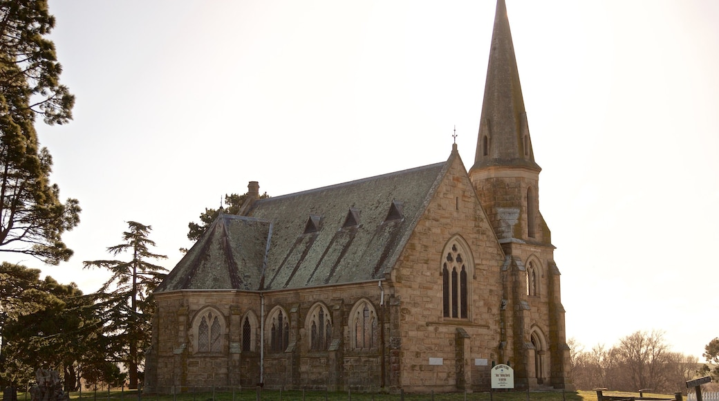 Ross which includes heritage architecture, a church or cathedral and a sunset
