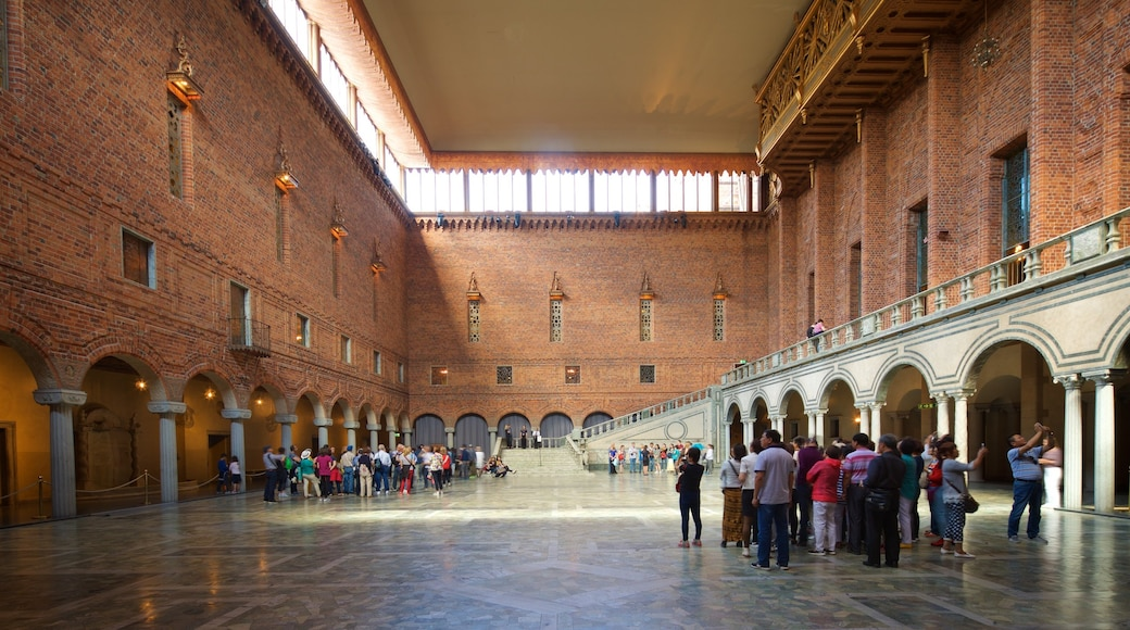 Stockholm City Hall showing interior views and heritage elements as well as a small group of people