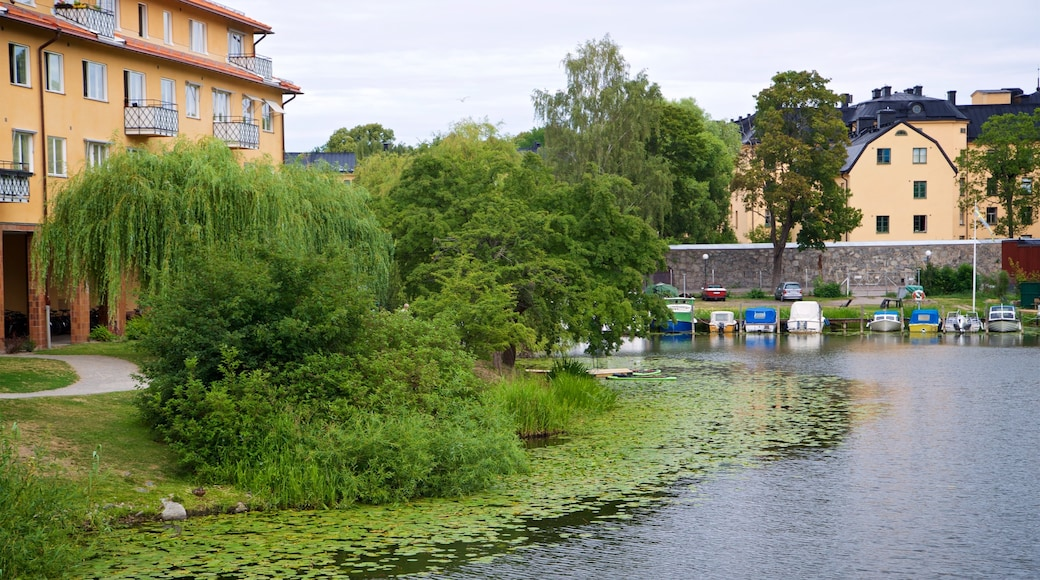 Langholmen which includes a small town or village and a pond