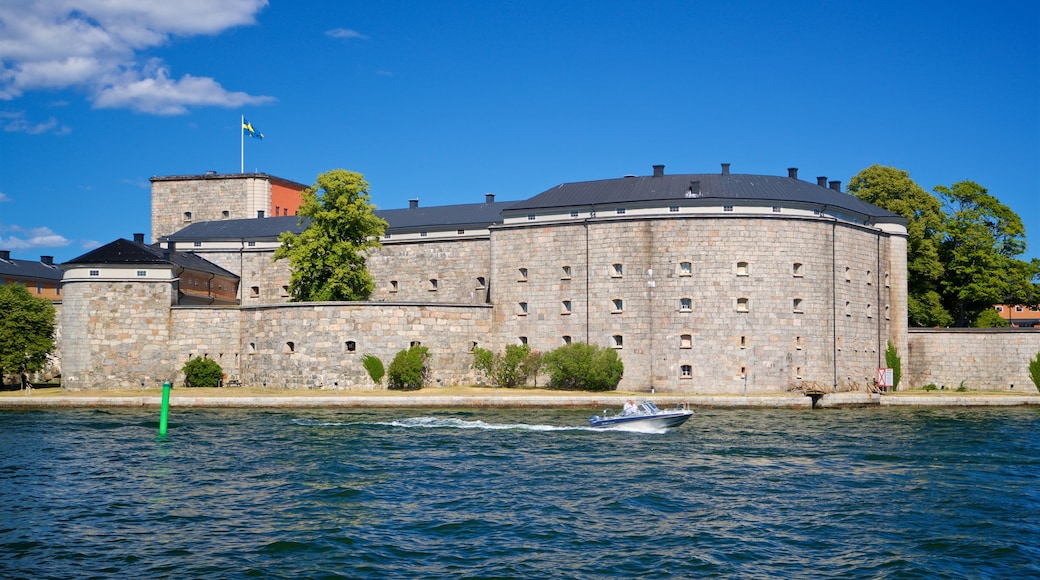 Vaxholm Fortress which includes a castle, a bay or harbor and boating