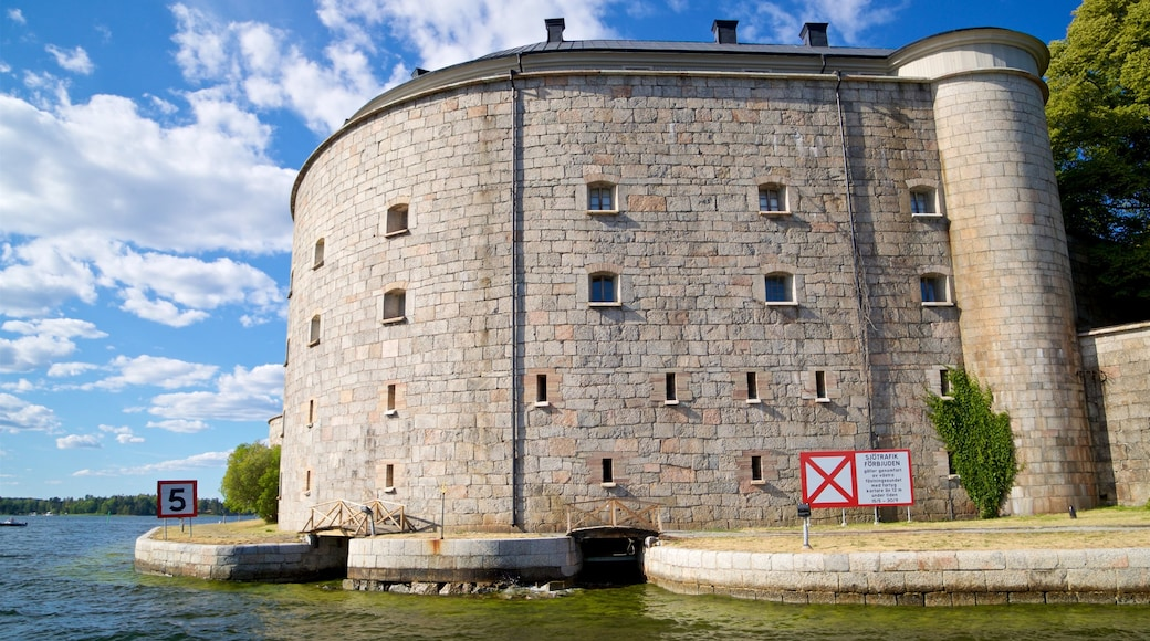 Vaxholm Fortress which includes heritage architecture and a river or creek