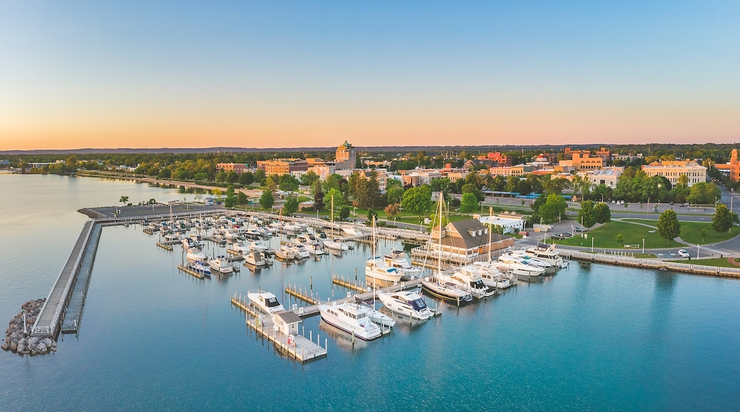 Traverse City which includes a sunset, landscape views and a bay or harbor
