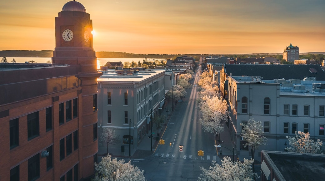 Traverse City showing a sunset, a city and landscape views